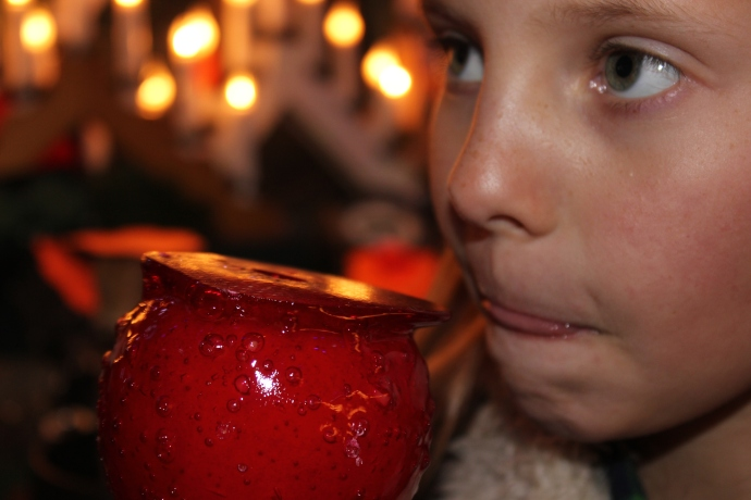 Enjoying a candied apple.