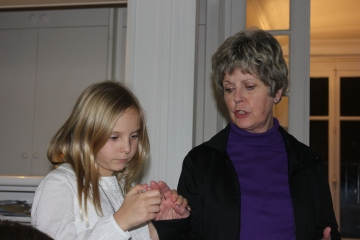 Sarah and Grandma exchanging hand massages.